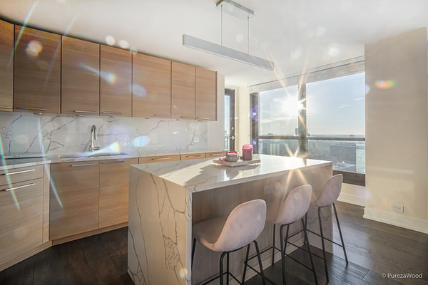 French White Oak wide plank engineered hardwood flooring in a high rise condominium in Chicago, the Gold Coast