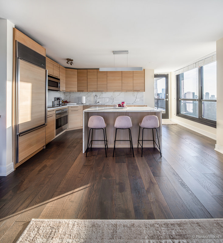 Wide plank french white oak hardwood flooring in a modern kitchen